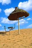 Relaxing area on sand desert — Stock Photo