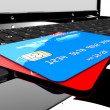 Two credit cards on laptop — Stockfoto