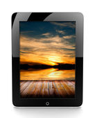 Tablet with sunset — Foto de Stock