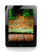 Tablet with brick wall — Stock Photo