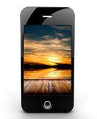 Gün batımı ile smartphone — Stok fotoğraf