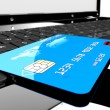 Credit card on laptop - Stock Photo