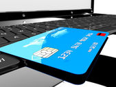 Credit card on laptop — Stock Photo