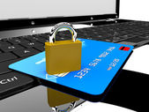 Credit card en vergrendelen op laptop — Stockfoto