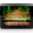 Tablet with brick wall — Lizenzfreies Foto