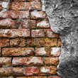Brick wall with cracked concrete — Foto Stock