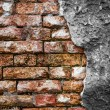 Brick wall with cracked concrete — Stock Photo