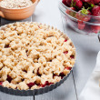 Strawberry crumble with ice cream and muesli — Stock Photo