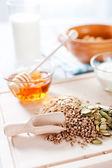 Fitness breakfast with healthy muesli and seeds — Stock Photo