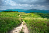 Hiking trail in mountains landscape — Stock Photo