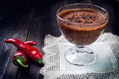 Dark and delicate chocolate mousse with chilli pepper — Stock Photo