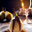Delicious pear dessert with chocolate and amaretto liqueur — Stock Photo #32276355
