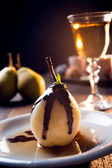 Delicious pear dessert with chocolate and amaretto liqueur — Stock Photo