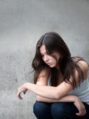Teenage girl looking thoughtful about troubles — Stock Photo