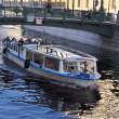 Stok fotoğraf: Excursion boat on canal Griboedova.Saint -Petersburg.