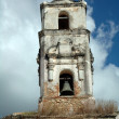 Stock Photo: Shabby belltower of church