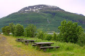 Wooden picnic table against Norwegian landscape — Stock Photo