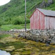 Neglected fisherman's house at the fjord coast, Lofotens, Norway - Stock Photo