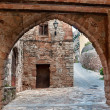 Street with an arch, Collbato, Spain — Stock Photo #8613710