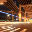 Night traffic under the viaduct - Stock Photo