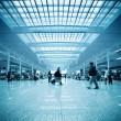 Passengers motion blur in train station — Stock Photo