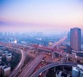 Cloverleaf interchange at dusk — Stock Photo