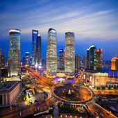Aerial view of shanghai skyline at night — Stock Photo