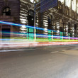 Light trails on old building — Stock Photo