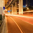 City traffic under the viaduct at night — Stock Photo