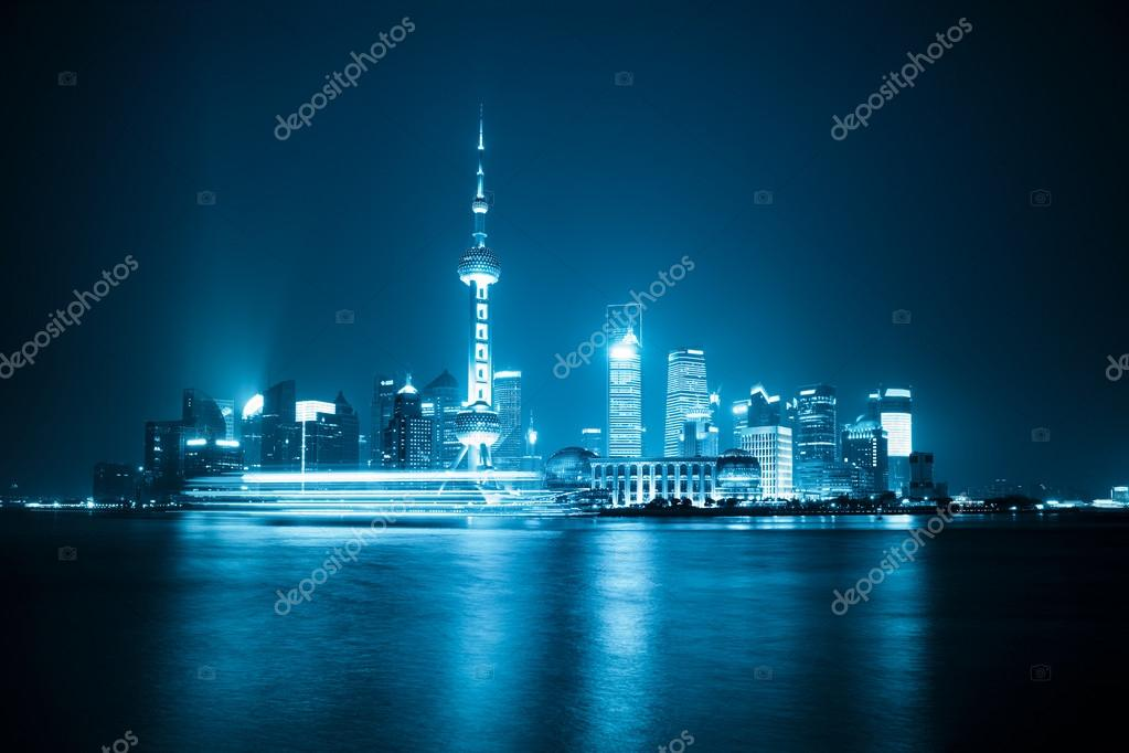 Shanghai skyline at night with blue tone — Stock Photo #13131281