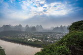 Karst mountain landscape with sunlight through the clouds — Stock Photo