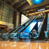 Moving escalators in lobby at night — Stock Photo
