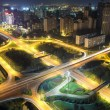 Night traffic on the highway overpass — Stock Photo #16164255