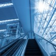 Escalator in airport terminal — Stock Photo #16169067