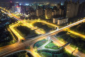 Night traffic on the highway overpass — Stock Photo