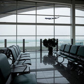 Chair and airport — Stock Photo