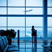 Passenger silhouette in airport — Stock Photo
