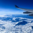 Plane wing and the himalayas - Stock Photo