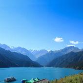 Heavenly lake with sightseeing cruises — Stock Photo