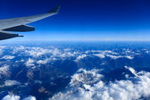 The himalayas and plane wing — Stock Photo