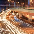 Foto Stock: Light trails on viaduct ramp