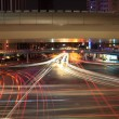Light trails on the crossroads — Stock Photo