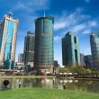 City park and modern buildings — Stock Photo