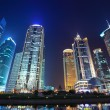 Modern buildings in night shanghai — Stock Photo