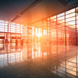 Modern airport terminal and flight - Stock Photo