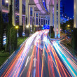 Light trails under the elevated road — Stock Photo