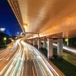 Night viaduct with light trails - Stock Photo