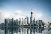 Shanghai skyline with reflection — Stock Photo