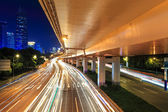 Night viaduct with light trails — Stock Photo