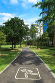 Jogging road in city park — Stock Photo